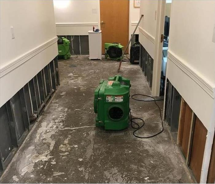 stripped hallway with drying equipment