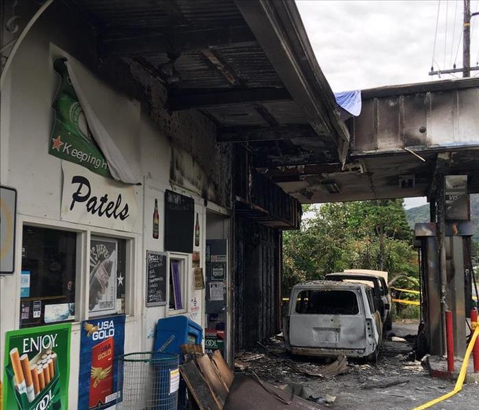 Side of the gas station with doors and windows affected with fire damage