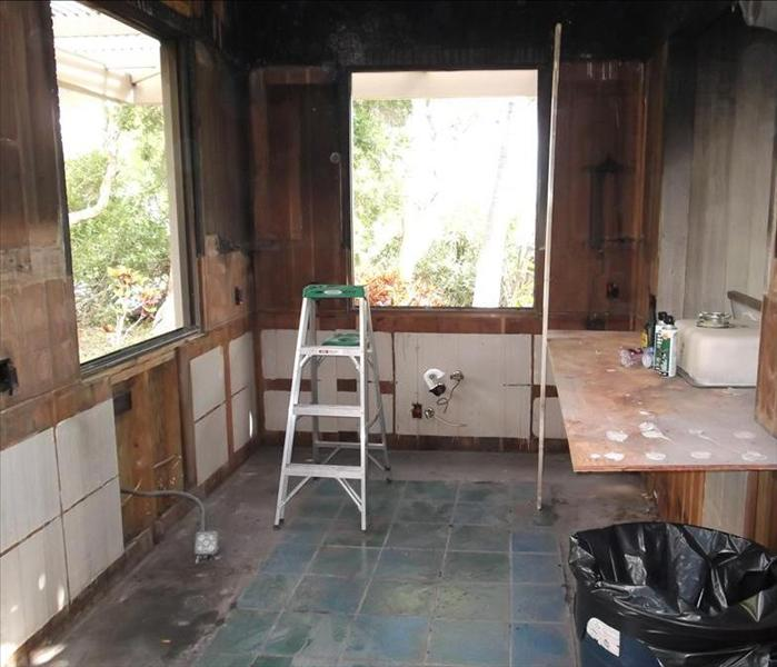 stripped out kitchen after mitigation