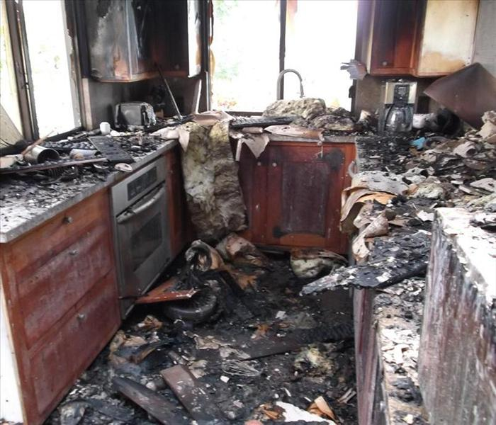 kitchen affected with fire and fire debris