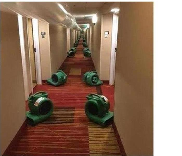 Hotel hallway setup with dryers after a water damage